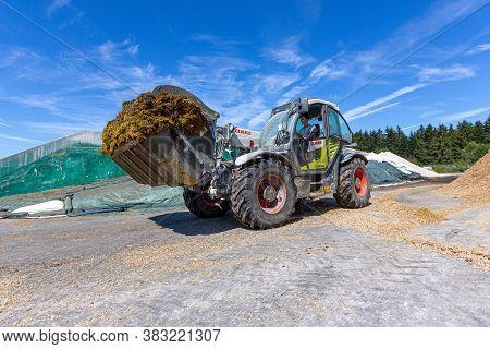 Bavaria / Germany - August 20, 2020: Claas Telescopic Handler Skorpion, Working On A Biogas Plant