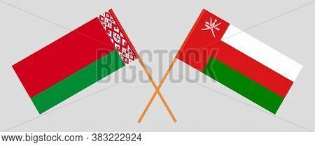 Crossed Flags Of Belarus And Oman. Official Colors. Correct Proportion. Vector Illustration