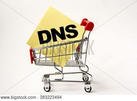 Shopping Cart And Text Dns Domain Name System On White Paper Note List. Shopping List, Business Conc