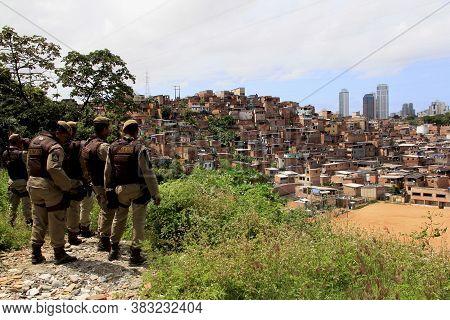 Salvador, Bahia / Brazil - August 23, 2013: Military Police Watch Favela Homes In The Saramandaia Ne