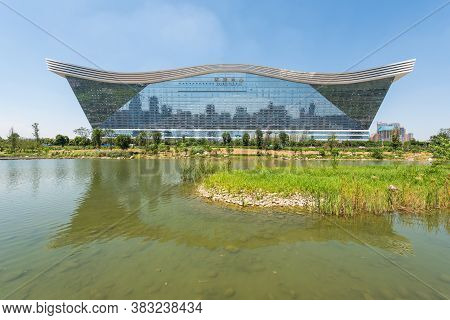 Chengdu, Sichuan Province, China - Aug 26, 2020 : New Century Global Center Building Reflecting In A