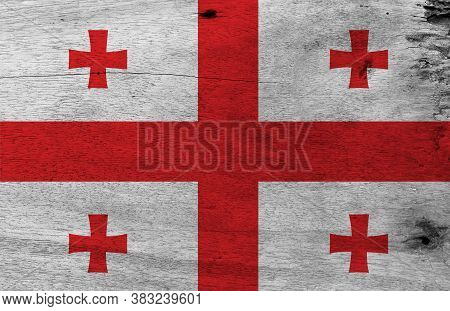 Flag Of Georgia On Wooden Plate Background. Grunge Georgia Flag Texture, White Rectangle, With A Lar