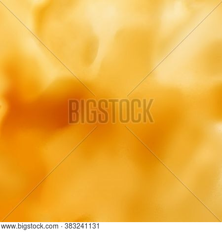 Abstract Sweet Caramel Sauce  Background. Liquid Melted Caramel Or Maple Syrup Texture