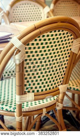 Wicker rattan chair in cafe restaurant