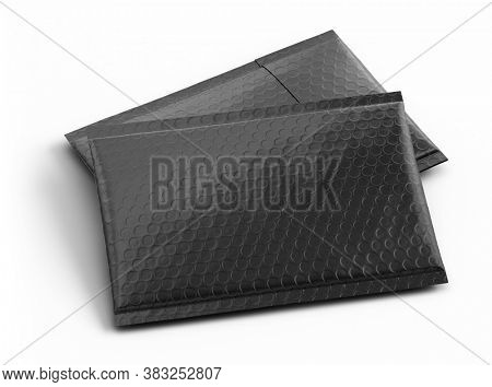 Pair of Small black paper delivery mail post packet isolated on the white background. Mockup template. copy space. 3d rendering