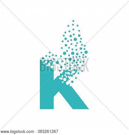 Letter K Dispersing Into A Cloud Of Bubbles.