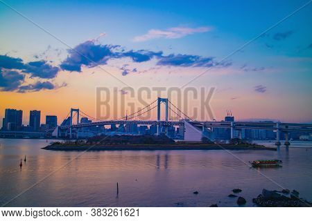 Tokyo / Japan - March 15, 2019: Rainbow Bridge At Odaiba, Tokyo In The Evening Sunset. This Suspensi