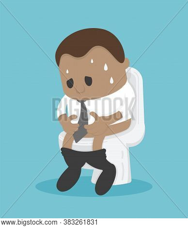 African Businessman Sitting On The Toilet With His Stomach Ache And Possibly A Bowel Disease