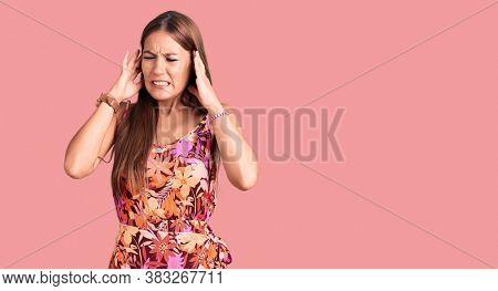 Young beautiful hispanic woman wearing casual clothes covering ears with fingers with annoyed expression for the noise of loud music. deaf concept.