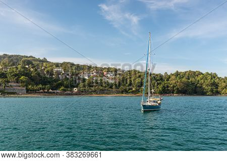Phuket, Thailand - November 29, 2019: Sailing Yacht Is Anchored On Patong Bay In The Harbor Of Phuke