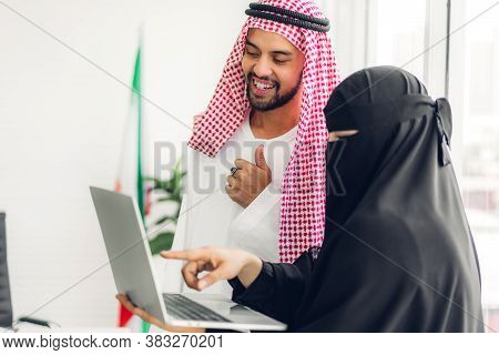 Successful Of Two Arabic Business People Working With Laptop Computer.creative Arab People Planning