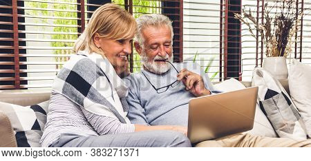 Senior Couple Family Having Good Time Using Laptop Computer Together.happy Elderly Husband And Wife