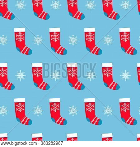 Seamless Pattern With Red Christmas Stockings And Snowflakes On Blue Background. Christmas, Winter C