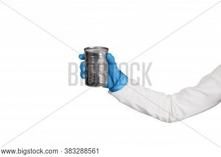 Female Hand In Blue Disposable Gloves Holds Tin With Canned Food Or Preserves. Kitchen And Food Conc