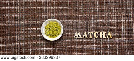 Japanese Green Powder Matcha Tea On A Platter, On A Brown Background. Inscription Of The Wooden Lett