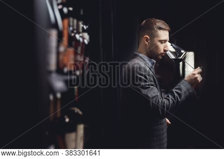 Winemaker Sommelier Man Sniffing Aroma Red Wine In Glass