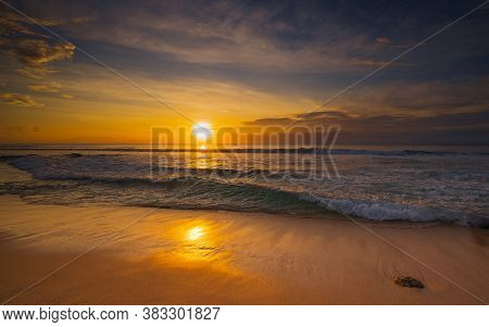 Beach At Sunset. Seascape. Bright Sunlight. Sun At Horizon Line. Scenic View. Sunset Golden Hour. Su
