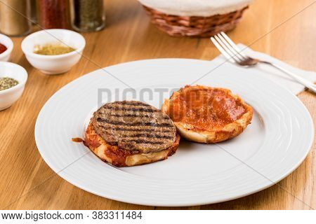 Delicious Turkish Islak Hamburger Or Wet Burger On Wooden Table