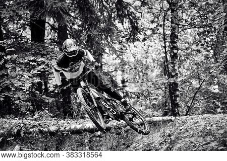 Russia, Moscow - Sep 01, 2020: Young Boy Jumping With His Mtb Bike At Forest. Professional Downhill