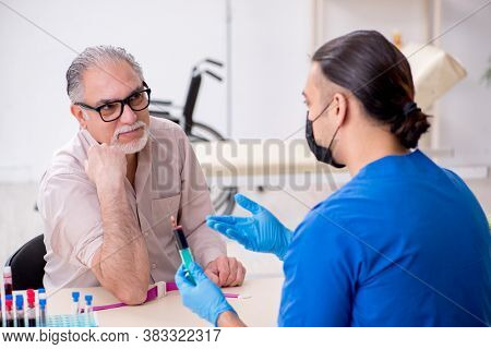 Old patient visiting young male doctor in blood transfusion conc