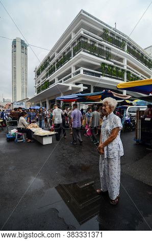 Georgetown, Penang/malaysia - Jun 17 2016: An Elder Woman Stand At The Street At Jalan Kuala Kangsar