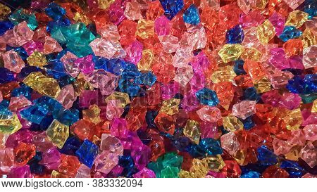 Background. Background From Multi-colored Stones. A Large Pile Of Multi-colored Stones Of Various Cu