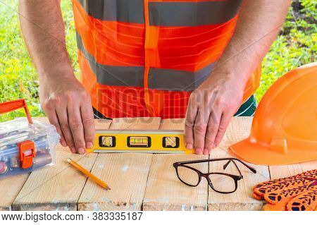 The Master Builder Levels The Surface Of The Boards With Building Level Before Planning The Work