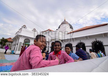 Georgetown, Penang/malaysia - Sep 12 2016: Muslim Kids Wait At Masjid Kapitan Keling On Friday.