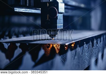 Cnc Laser Machine Cutting Sheet Metal With Light Spark. Technology Plasma Industrial, Blue Steel Col