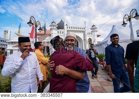 Georgetown, Penang/malaysia - Sep 12 2016: Two Muslim Friend Hug Each Other Ar Masjid Kapitan Keling