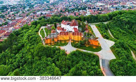 Brasov, Romania. Amazing Illuminated Aerial View Of The Citadel, Medieval Fortress In Transylvania