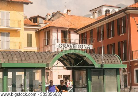 Gravedona. Lake Como. Italy - July 21, 2019: Ferry Pier in the Commune of Gravedona. Lombardy. Signboard with Name of the City.
