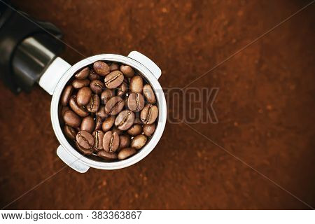 In The Holder Of The Coffee Machine Are Roasted Aromatic Coffee Beans, And The Holder Is On The Back