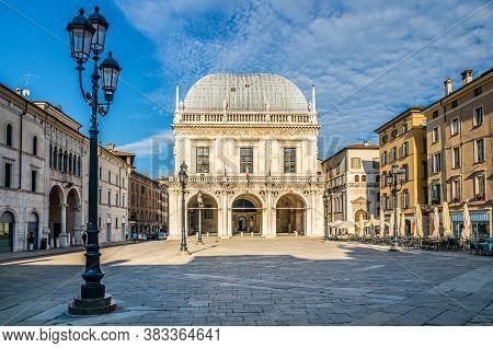 Palazzo Della Loggia Palace Town Hall Renaissance Style Building And Street Lights In Piazza Della L