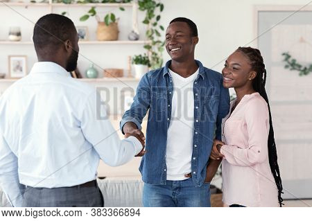 Male Family Therapist And Happy Black Couple Handshaking In Office After Meeting, Spouses Grateful T