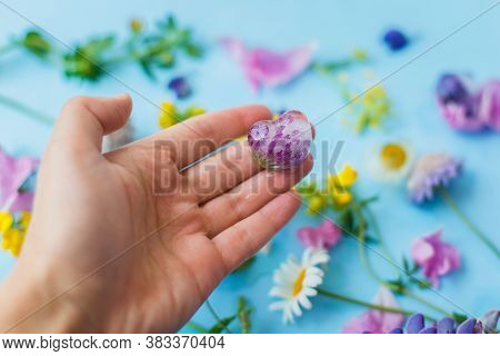 Hand Holding Floral Ice Cube From Fresh Summer Flower. Colorful Wildflowers In Frozen Ice Hearts On