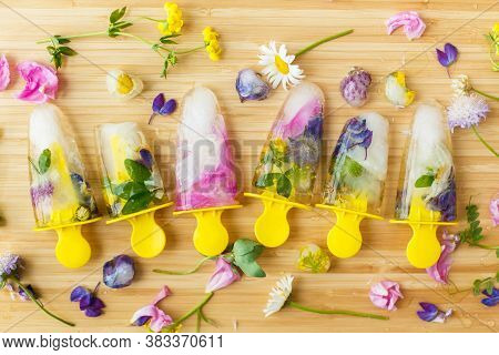Floral Ice Pops And Fresh Summer Flowers Flat Lay. Colorful Wildflowers In Melting Ice Hearts And Po