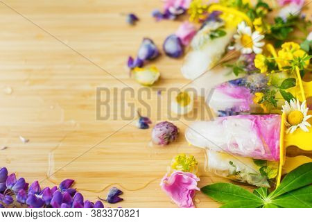 Floral Ice Pops And Fresh Summer Flowers With Space For Text. Colorful Wildflowers In Melting Ice He