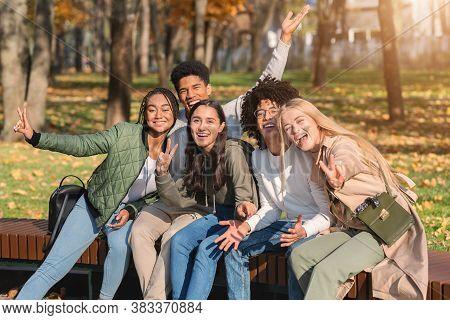 Multiracial Group Of Carefree Teenagers Posing At Public Park, Having Fun Outdoors