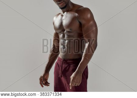 Cropped Shot Of Muscular African American Man Showing His Naked Torso While Posing Shirtless Isolate
