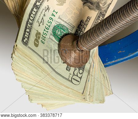 Concept For Financial Stress Or Recession. Usa Twenty Dollar Bills Being Squeezed Between The Jaws O