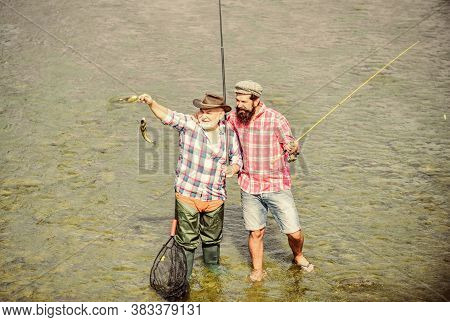 Working Together Is Success. Fisherman With Fishing Rod And Net. Hobby And Sport Activity. Trout Bai