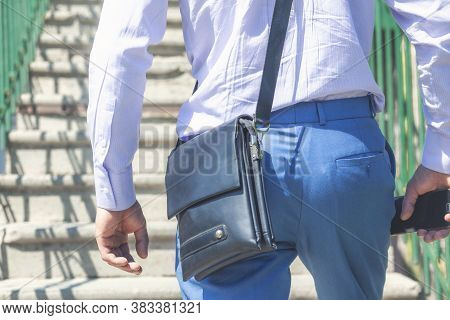 Rear View Of Businessman With Leather Briefcase Going Up Stairs.