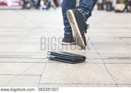Man Had Lost Leather Wallet With Money On The Floor. Close-up Of Wallet Lying On The Sidewalk And Fe