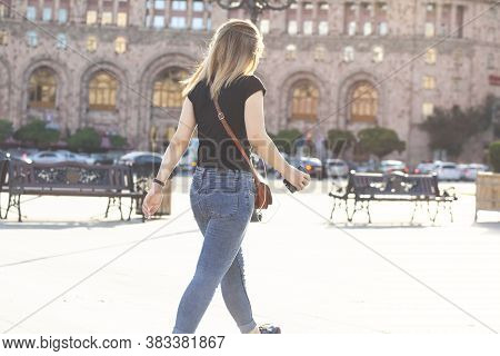 Beautiful Girl Walks Around The City In Jeans.