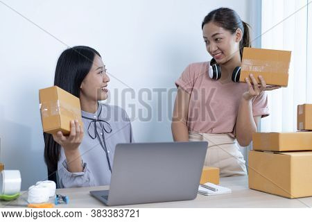 Two young Asian women helped sell their products online and happily prepared to deliver their produc