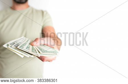 Front View Midsection Of Caucasian Man Offering Or Handing Over Money To Someone Else Against White