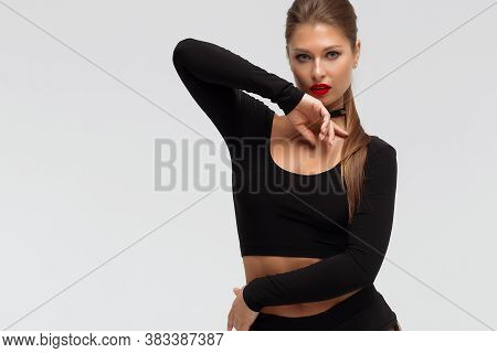 Full Body Of Provocative Young Slim Female With Red Lips Wearing Black Underwear And High Heeled Boo