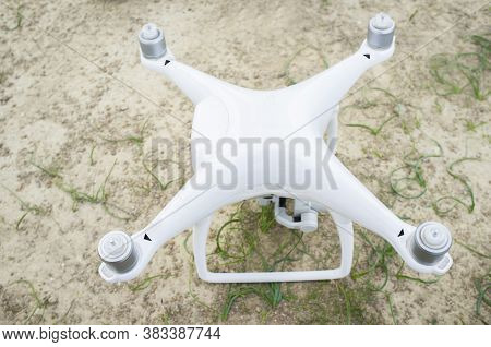 Drone With Rotors At Work But No Propellers Mounted. Overhead View