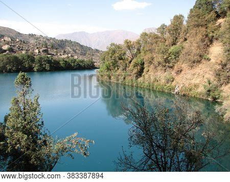 Beautiful Turquoise Lake In The Pamir Mountains Of Tajikistan